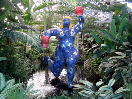 Blue woman with red pots in each hand pouring water
